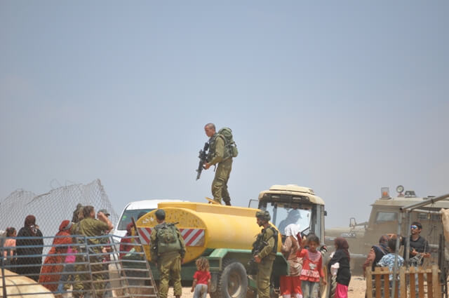 Israeli occupation forces confiscate a portable water tank in Al Maleh 21 June 2012 3