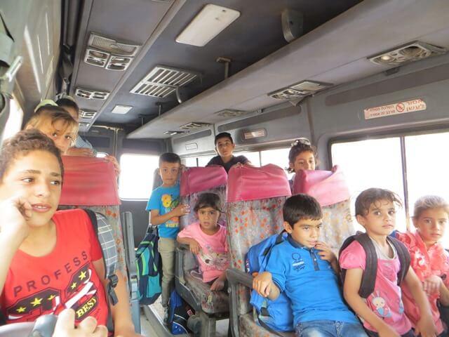 Children travelling to school in the JVS school bus